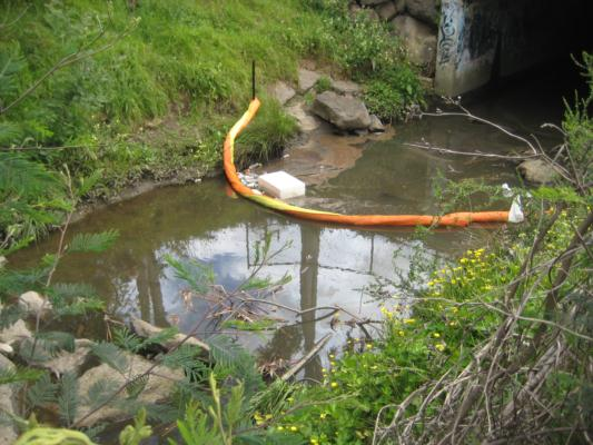 litter trap strung across the waterway at YDI847