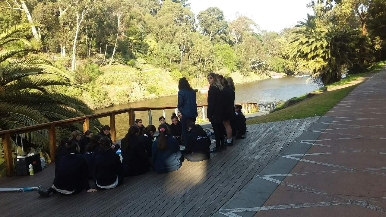 MGC students sampling on the Yarra River at the conoe launch with Julia