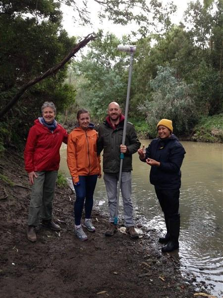 some of the group with the Creek in background- higher flow and more muddy than previous sampling