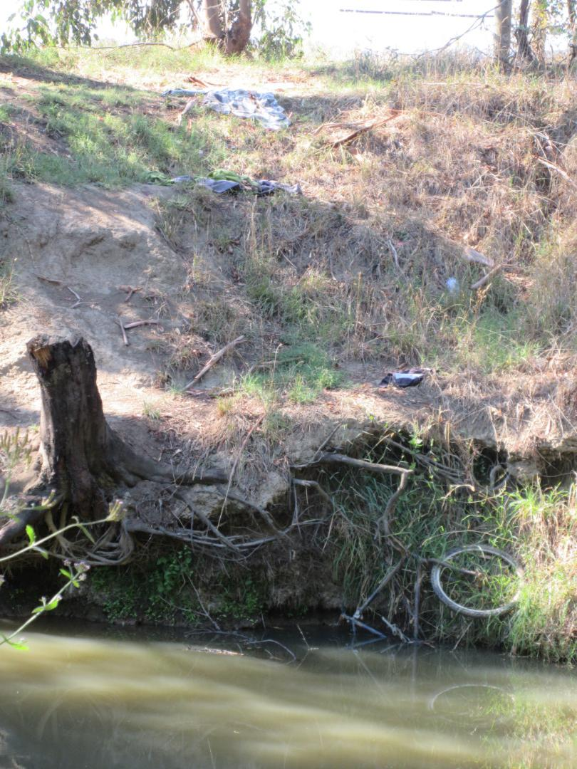 Damage to bank and rubbish at swimming hole